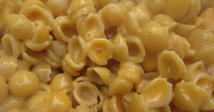 close up of macaroni and cheese with mini shell pasta