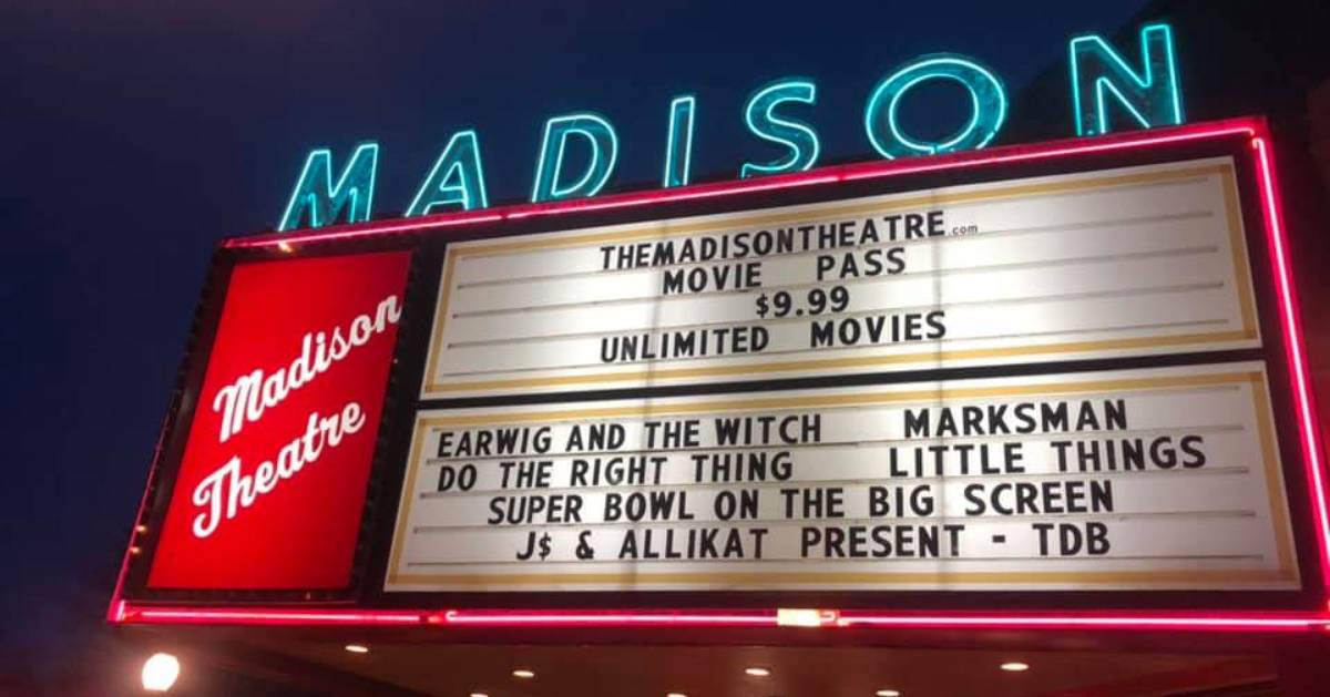 Madison Theatre sign with showtimes