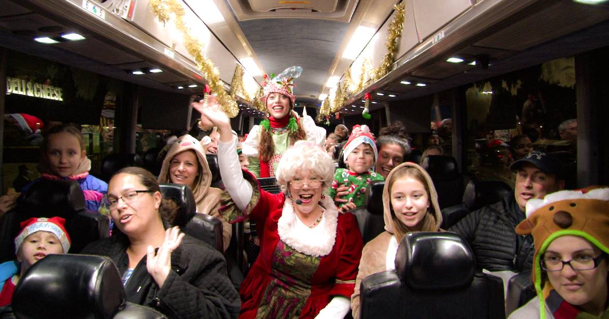 people on a holiday themed bus ride