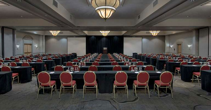 meeting room with tables and red chairs