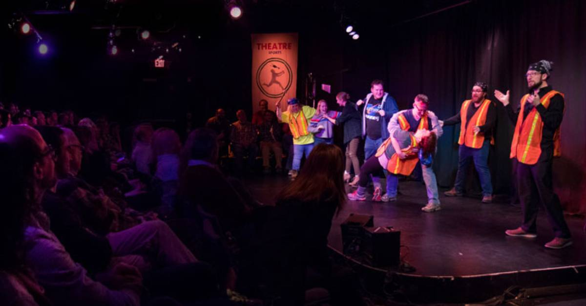 people performing improv on stage