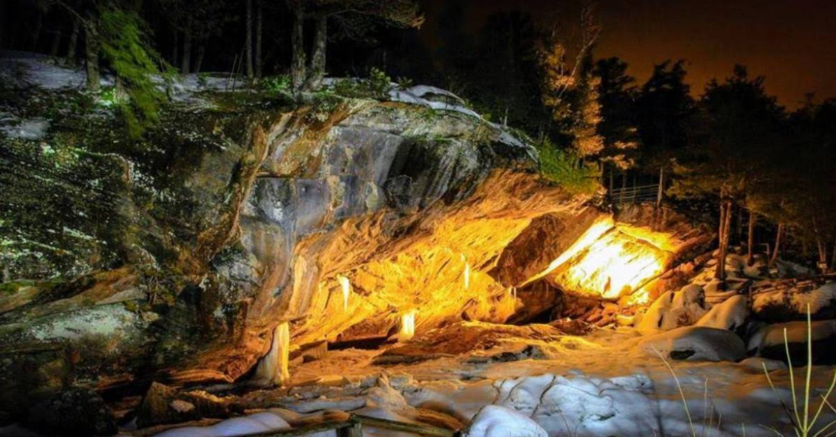 a large cave entrance with yellow lights