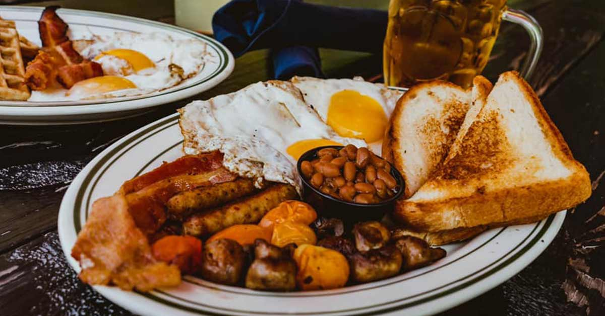 plate of eggs, toast, and breakfast meats