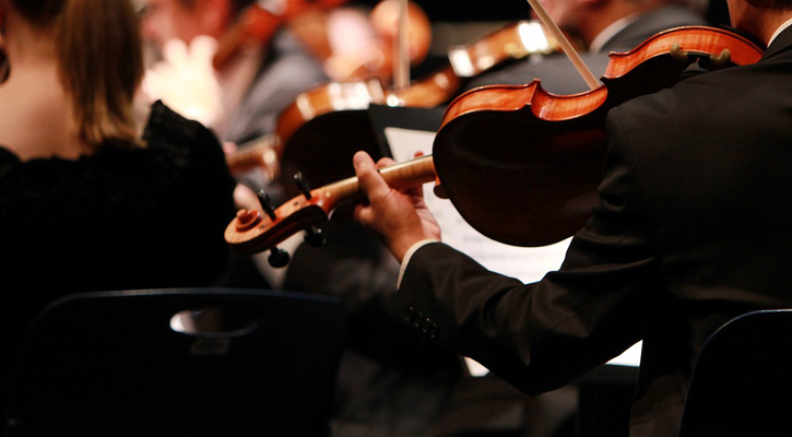 close up of a violin in an orchestra