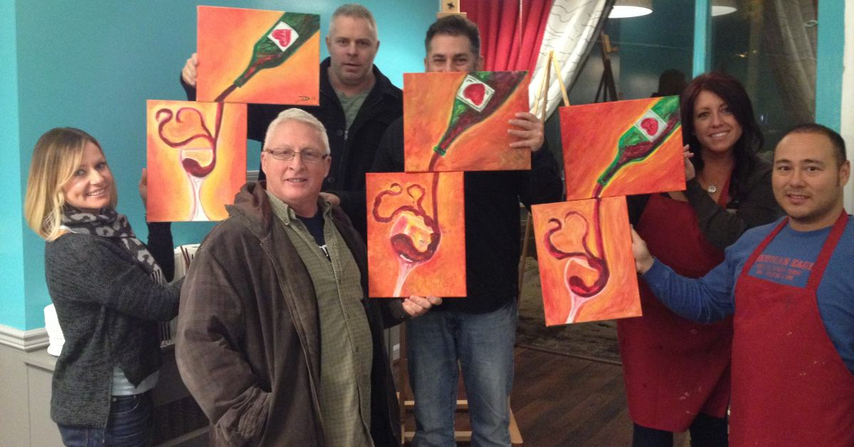group of people at paint and sip