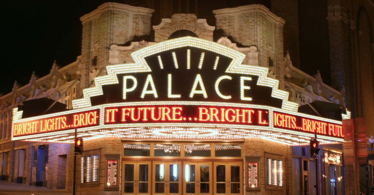 exterior of the palace theatre lit up at night