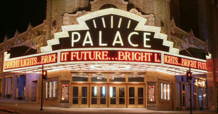 the outside of The Palace Theater all lit up at night