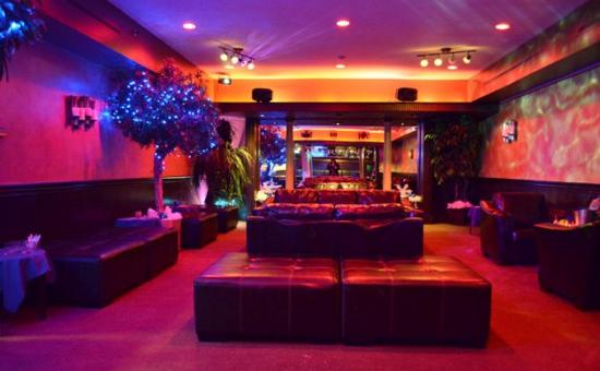 couches in nightclub lighting