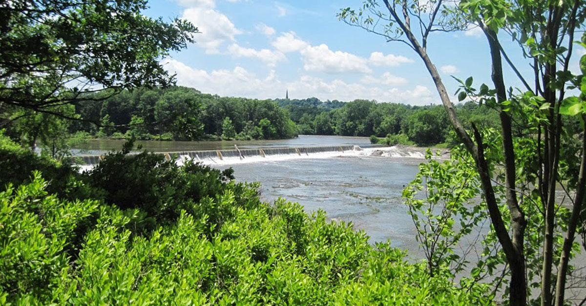 view of dam and waterfall at peebles island state park