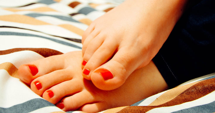 feet with red nailpolish