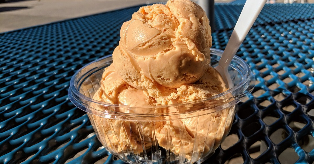 bowl of pumpkin ice cream on a blue table