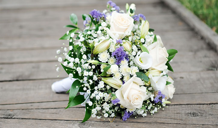 bouquet with white roses and purple flowers