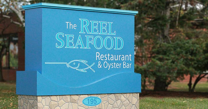 Sign for Reel Seafood Restaurant and Oyster Bar in Albany NY