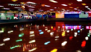 rollerskating rink lit up by black lights