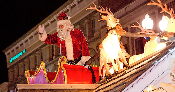 Santa waving to the crowd from his float at the parade