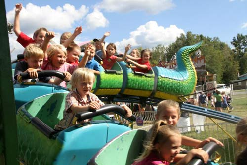 children riding ride at the saratoga county fair