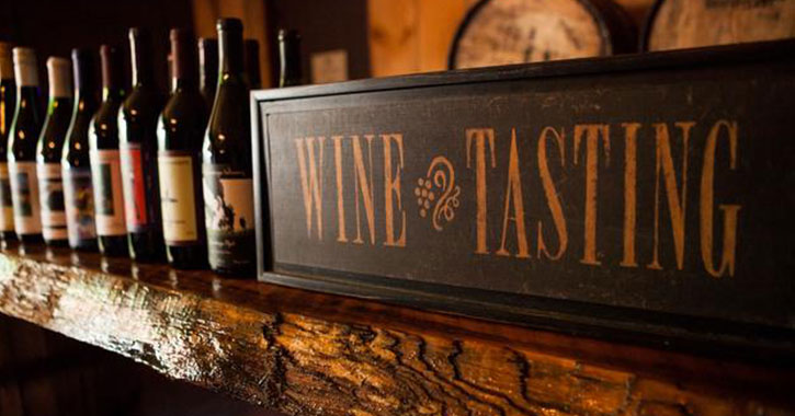 wine tasting sign and bottles