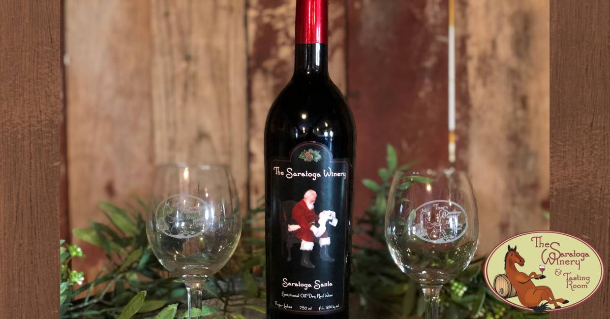 bottle of saratoga winery santa wine and two wine glasses