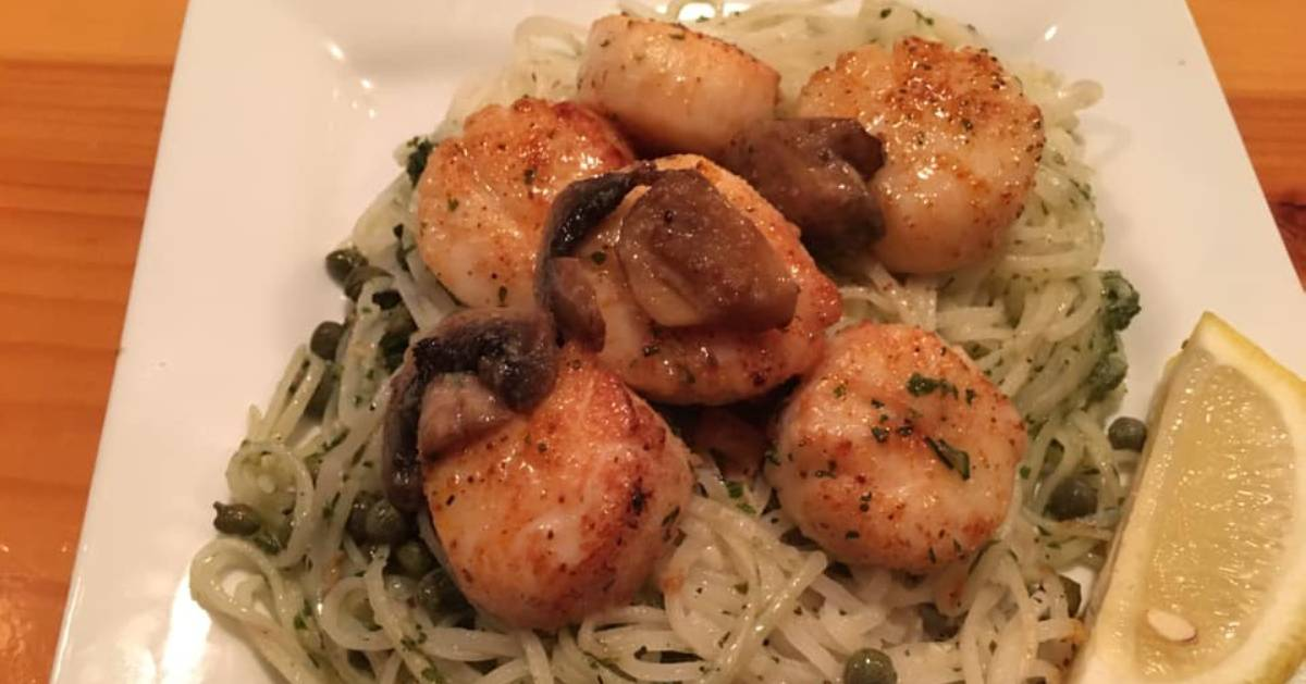 scallops and pasta on a plate