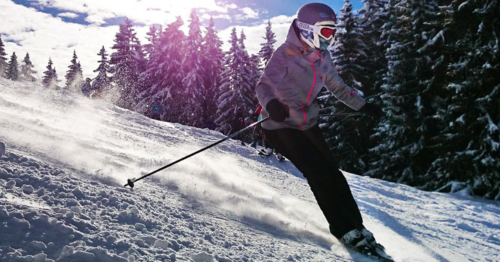 a girl skiing downhill intensely