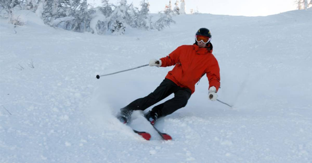 skier with red jacket on