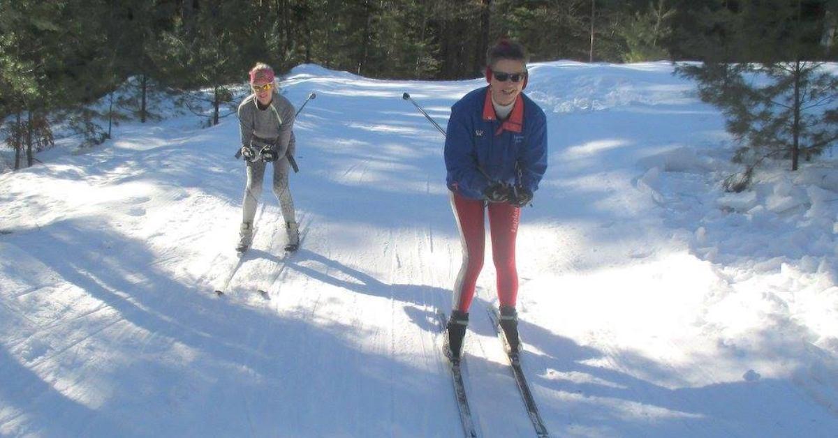 two women cross country skiing