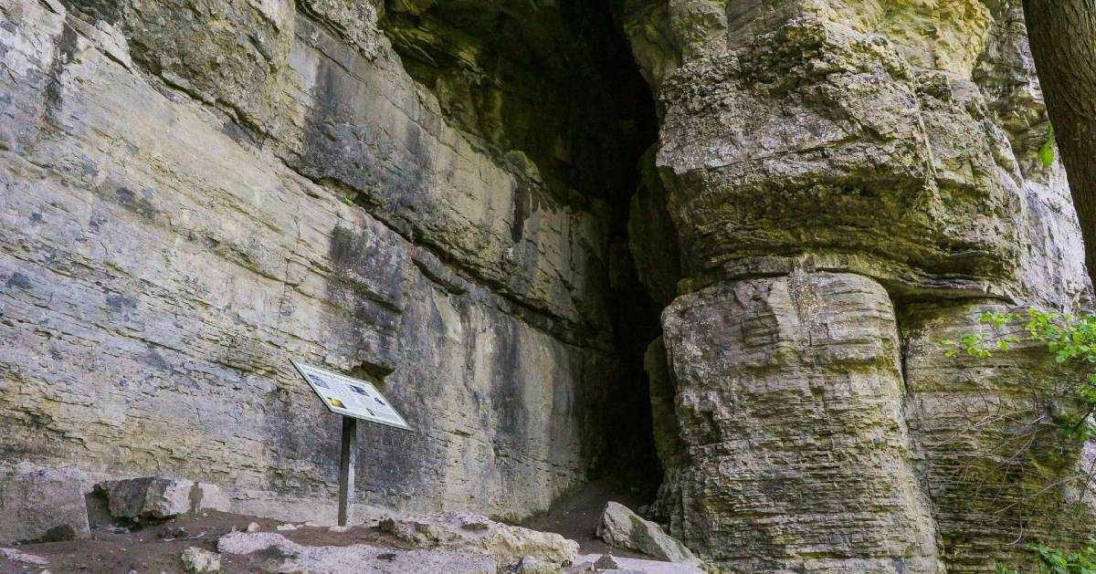 sign near stone cliffs