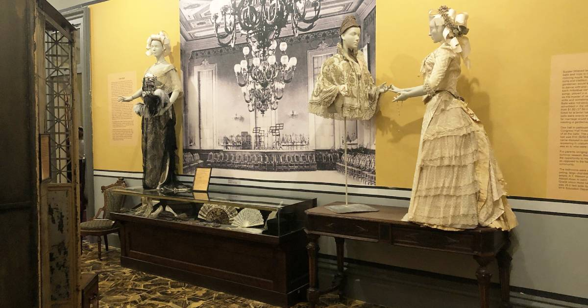 a historic exhibit with artworks and antiques
