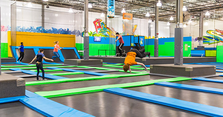 kids playing around in a trampoline park