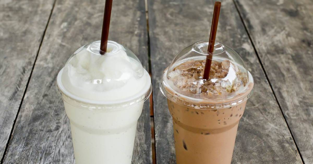 two milkshakes in plastic cups