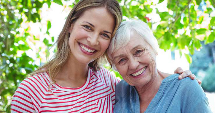 woman with an older woman smiling