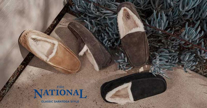 UGG slippers underneath the tree with The National text