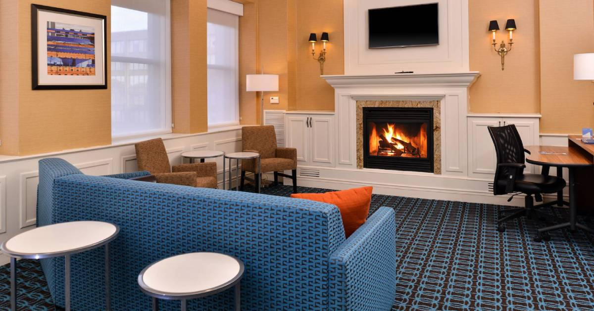 blue sofa and other furniture in a room with a fireplace