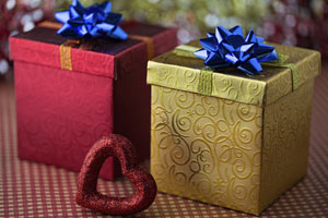 red box and gold box each with a blue bow, heart in front
