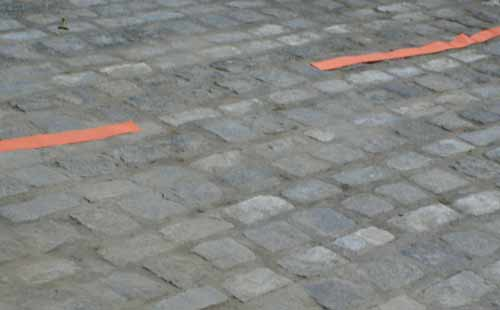 Cut Ribbon Draped Over Relaid Cobblestones On The Street