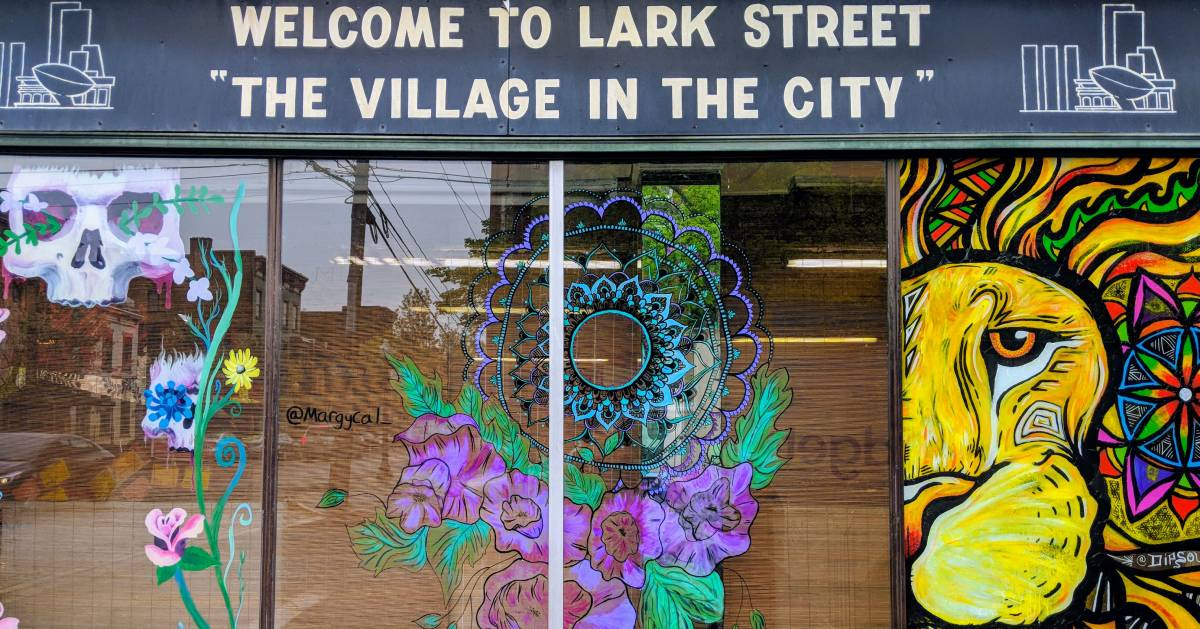 Lark Street window and sign saying welcome