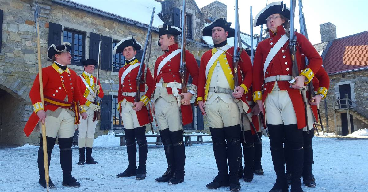 group of reenactors in red solider outfits