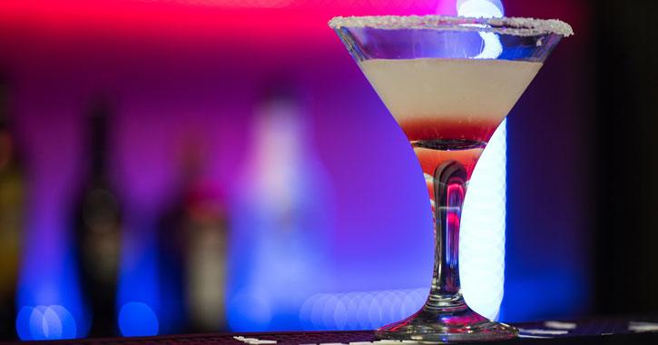 a festive looking martini at a bar