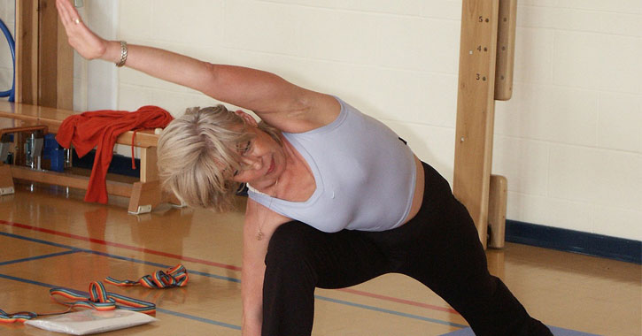 a woman in her 50s or 60s doing yoga