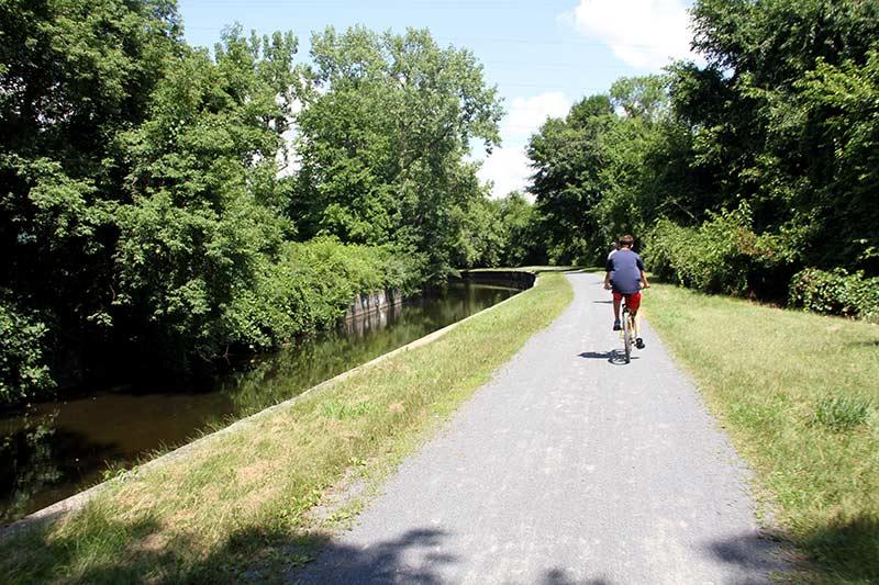 biking on bike path along a canal