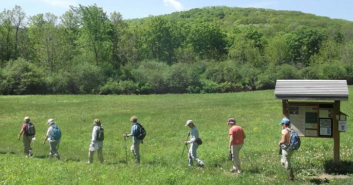 a group hikes at bozen kill preserve
