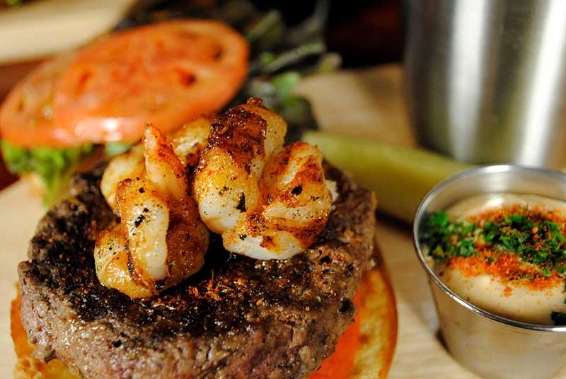 Shrimp topped burger, called the Surf & Turf Burger at The Hollow Bar + Kitchen in Albany NY