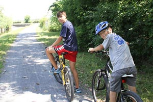kids biking on trails