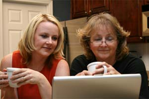 Senior mom researching senior living with daughter