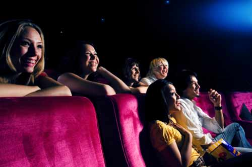 people smiling at a movie theater