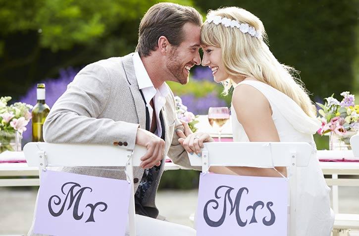 newlyweds at wedding ceremony smiling