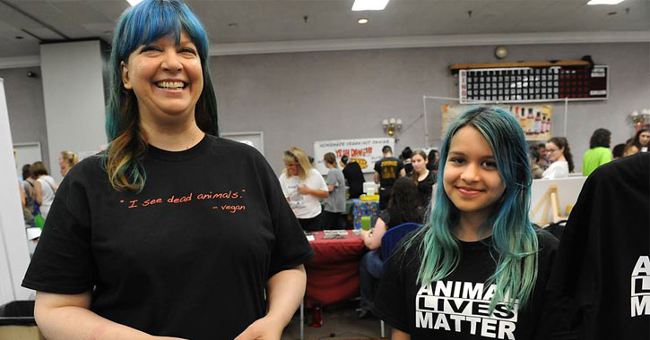 woman and young girl in vegan-themed tee-shirts