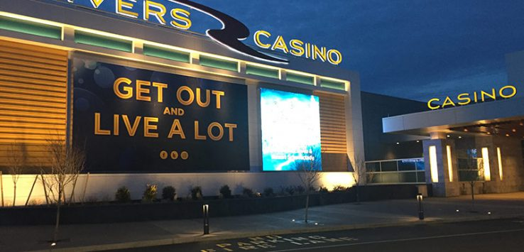 Outside of rivers casino with large lit up billboard