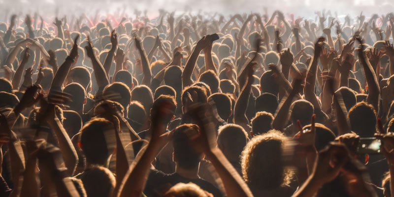 a crowd going wild at a concert
