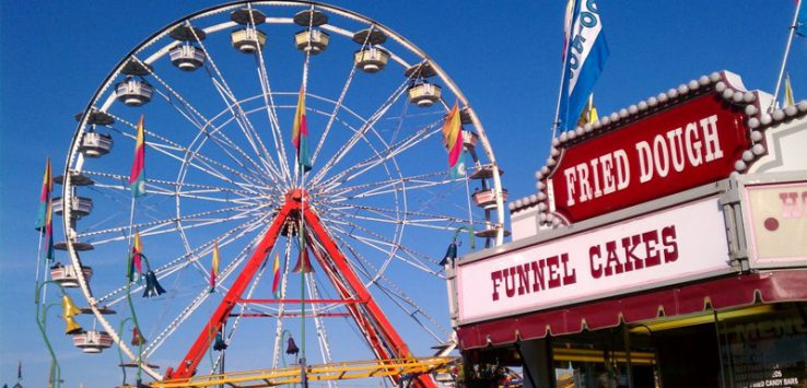a Ferris wheel and food stand at the fair